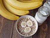 Oat porridge with bananas and yogurt — Stock Photo