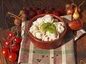 Dumplings with meat on a wooden table — Zdjęcie stockowe