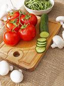 Cucumbers, tomatoes, mushrooms and arugula — Stock Photo