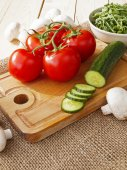 Cucumbers, tomatoes, mushrooms and arugula — Stock Photo