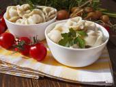 Dumplings with meat on a wooden table — Stock Photo