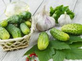 Fresh cucumbers on a wooden table — Stock Photo