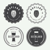 Set of vintage beer and pub logos, labels and emblems with bottles, hops, and wheat — Stock Vector