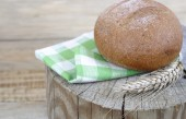 Bread on a wooden background. — Stock Photo