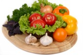 Fresh vegetables on a board on a white background. — Stock Photo