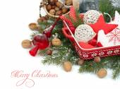 Christmas background with textile jewelry and nuts. — Stock Photo