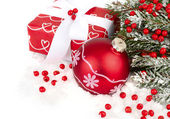 Christmas background with a red Christmas ball and a gift. — Stock Photo
