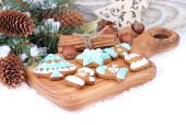 Christmas background with branches of a Christmas tree and ginger cookies. — Stock Photo