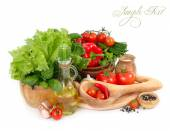 Fresh vegetables in wooden ware on a white background. — Stock Photo
