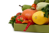 Fresh vegetables in a green box on a white background. — Stock Photo