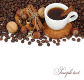 Cup of coffee on coffee grains on a white background. — Stock Photo