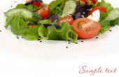 Salad with arugula and sesame on a white background. — Stock Photo