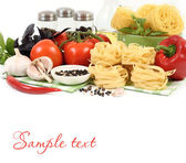 Pasta and fresh vegetables on a white background. — Stock Photo