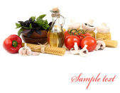 Pasta and fresh vegetables on a white background. — Foto Stock
