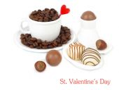 Cup of coffee and chocolates on a white background. — Stock Photo