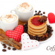 Two cups of coffee with cream and textile hearts on a white background. — Stock Photo #62137283