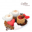 Two cups of coffee with cream and textile hearts on a white background. — Stock Photo #62137341