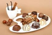 Chocolates on a beige background. — Foto Stock