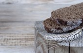 Rye bread on a wooden background. — Stock Photo