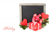 Roses and a red gift box on a white background. — Stock Photo