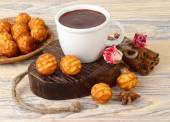 Cup of hot chocolate on wooden heart and biscuit cookies on a wooden background. — Stock Photo