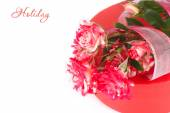 Roses of unusual color on a red gift box on a white background. — Stock Photo