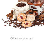 Cup of coffee with cookies, the coffee grinder and coffee grains on a white background. — Stock Photo
