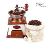 The manual coffee grinder and coffee grains in a knitted bag on a white background. — Stock Photo