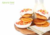 Orange biscuits with proteinaceous glaze and candied fruits on a white background. — Stock Photo