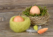 Easter eggs in a nest on wooden a rustic a background. — Stock Photo