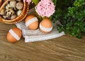 Easter background with a basket with quail both eggs and a hyacinth. — Stock Photo