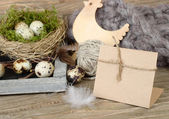 Easter background with eggs in a nest, wooden chicken and a place for the text. — Stock Photo