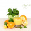 Glass of orange juice both various citruses and mint on a table on a white background. — Stock Photo #65954275