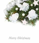 Christmas background with branches of a Christmas tree and white textile flowers. — Stock Photo