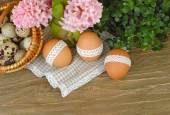 Easter eggs with a cotton band on wooden a rustic a background. Easter background. — Stock Photo