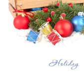 Color Christmas balls and drums in snow near a wooden box on a white background. Christmas background. — Stock Photo
