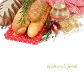 Fresh fragrant bread and rosemary on a white background. — Stock Photo