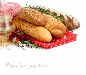 Fresh fragrant bread and rosemary on a white background — Stock Photo