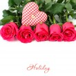 Roses and checkered textile heart on a white background. — Stockfoto #71839139