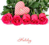 Roses and checkered textile heart on a white background. — Stock Photo