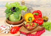 Fresh vegetables in wooden ware on a wooden background. — Stock Photo