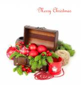 Red Christmas balls in a wooden chest on a white background. Christmas background. — Stock Photo