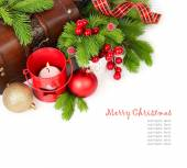 Christmas balls and red candlestick near a chest on a white background. Christmas background. Top view. — Stock Photo