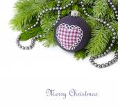 Violet Christmas ball with heart and a gray beads on branches of a Christmas tree on a white background. A Christmas background with a place for the text. — Stock Photo