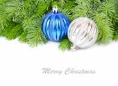 Blue and silvery Christmas balls on branches of a Christmas tree on a white background. A Christmas background with a place for the text. — Stock Photo