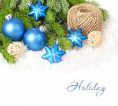 Blue Christmas balls and stars on branches of a Christmas tree on a white background. Christmas background. — Stock Photo