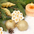 Golden Christmas balls and cones and cookies in the form of snowflakes on decorative snow on a white background. Christmas background. — Stock Photo #75281909