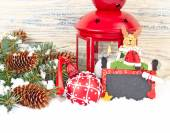 Christmas composition with a red lamp, a cretaceous board with a deer and a red Christmas ball on a wooden background. A Christmas background with a place for the text. — Stock Photo