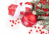Red Christmas ball, box and red berries on snow on a white background. Christmas background. — Stock Photo