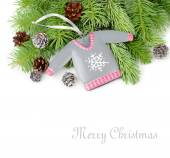 Decorative winter sweater and cones on branches of a Christmas tree. A Christmas background with a place for the text. — Stock Photo